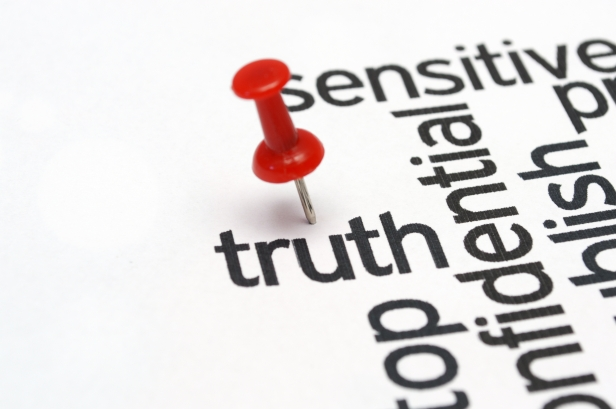 Push pin on Truth  text